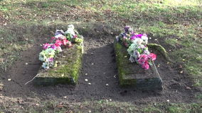 Two ancient All Souls Day grave in rural cemetery stock footage