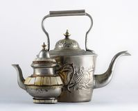 Two ancient Arabic teapots. Vintage old teapots. On a white background Royalty Free Stock Photo