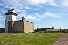 Two ancient fortresses on the parties from the river which is border. Narva, Estonia and Ivangorod behind the river, Russia. Stock Photos