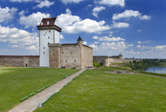 Two ancient fortresses on the parties from the river which is border. Narva, Estonia and Ivangorod behind the river, Russia. Royalty Free Stock Image