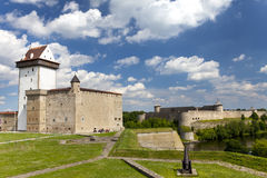 Two ancient fortresses on the parties from the river which is border. Narva, Estonia and Ivangorod behind the river, Russia. Stock Photography