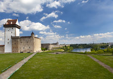 Two ancient fortresses on the parties from the river which is border. Narva, Estonia and Ivangorod behind the river, Russia. Royalty Free Stock Photos