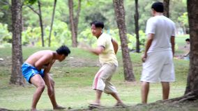Two ancient Muay Thai fighter are sparing outdoor. Two ancient Muay Thai (Muay Boran) fighter are sparing outdoor in the public park in Thailand stock video