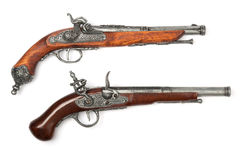 Two ancient pistols. On white background stock image