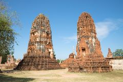 Two ancient prangs of the Buddhist temple of Wat Mahathat on a sunny day. Ayutthaya, Thailand Stock Images