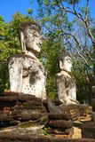 Two ancient sculptures of a sitting Buddha on the ruins of the temple of Wat Phra Kaeo. Kampaeng Phet, Thailand. Two ancient sculptures of a sitting Buddha close Royalty Free Stock Photography