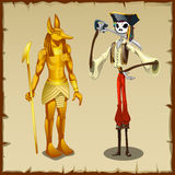 Two ancient symbols, Anubis figurine and pirate Stock Photo