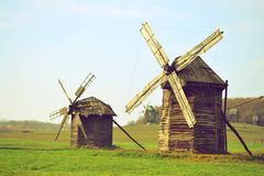 Two ancient windmills on the field Royalty Free Stock Image