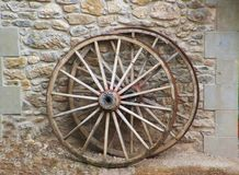 Two ancient wooden carriage wheels Stock Photography