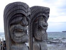 Two ancient wooden Tiki of Pu`uhonua o Honaunau National Park, Hawaii stock images