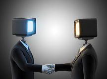 Two androids shaking hands Stock Photo