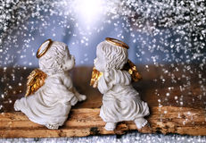 Two angel in the falling snow Stock Photography