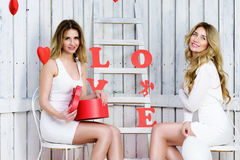 Two angel girls in white dresses smiling valentines day Royalty Free Stock Image
