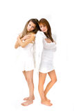 Two Angels. Side by side crossing their arms as a symbol of love Royalty Free Stock Photos