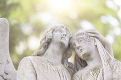 Two angels in backlit Stock Photos
