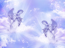 Two angels. With beams of light over a purple pink background Stock Image