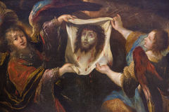Two angels holding the veil of Veronica Royalty Free Stock Image