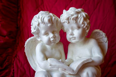 Two angels. Two little angel on a red background Royalty Free Stock Images