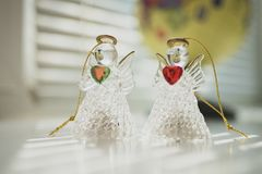 Two angels, messengers of peace and love. On the background of the globe royalty free stock images