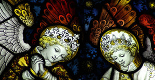 Two angels in stained glass. Stained glass window with two angels royalty free stock images