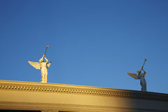 Two angle statues wall top of the wall in the morning sunshine Royalty Free Stock Photo