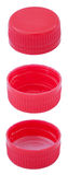 Isolated Red Plastic Bottle Caps. Two angles of a red plastic bottle cap. One of the top side and two of the bottom side (on with and one without the white Stock Image