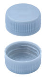 Isolated Silver Plastic Bottle Caps. Two angles of a silver plastic bottle cap Royalty Free Stock Photography