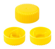 Isolated Yellow Plastic Bottle Caps Stock Photo