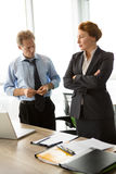 Two angry bosses man and woman in office Stock Images