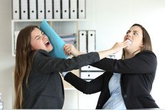 Two angry executives fighting at office. Two angry executives fighting hitting with folders at office royalty free stock image