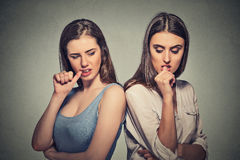 Two angry girls going through a conflict Stock Images