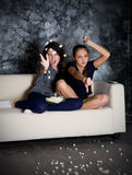 Two angry girls looks TV Stock Photography