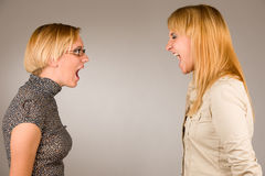 Two angry girls screaming on eachother Royalty Free Stock Image
