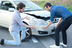 Two angry men arguing after a car crash Stock Image