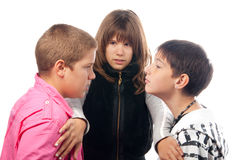 Two angry teenage boys and the girl Royalty Free Stock Photography