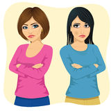 Two angry women looking at each other over shoulder with arms crossed Stock Photos