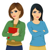 Two angry women looking at each other over shoulder and holding their arms crossed Royalty Free Stock Images