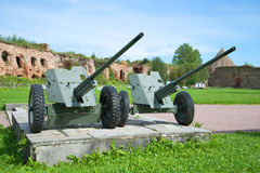 Two anti-tank guns during the Second world war in the fortress Oreshek. A fragment of the memorial to the defense of the fortress Stock Photo