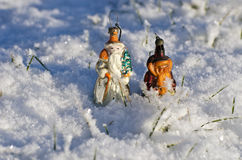 Two antique Christmas tree toys on winter snow Royalty Free Stock Images