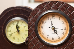 Two antique clocks Stock Photos