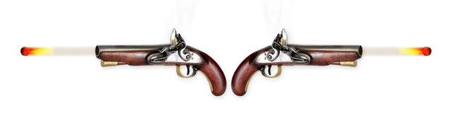Two Flintlock Pistols Firing. Royalty Free Stock Images