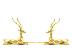 Two antique grunge brass deers sculpture isolated on white background Royalty Free Stock Photos