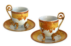 Two Antique porcelain cups and saucers Royalty Free Stock Image