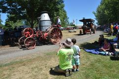Two Antique steam tractors, Brooks, Oregon. Two antique steam tractors roll down the road at Antique Powerland for an admiring crowd near Brooks, Oregon on a royalty free stock images