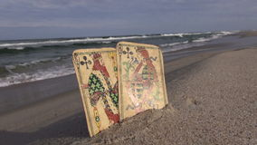 Two antique used playing cards of clubs – queen and king - by tsea. Two antique used playing cards of clubs – queen and king - by the sea stock video footage