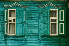 Retro windows with shutters on a wooden green wall Royalty Free Stock Photos