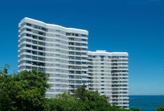 Two apartment-buildings by the sea. Two tall, white apartment-buildings by the sea Royalty Free Stock Images