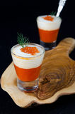 Two appetizers of sweet pepper, cream and red caviar in a glass Stock Image