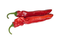 Two appetizing sweet red peppers isolatet on white Stock Photos