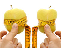 Two apple anche measurement tape, dieting concept. On white background Stock Photo